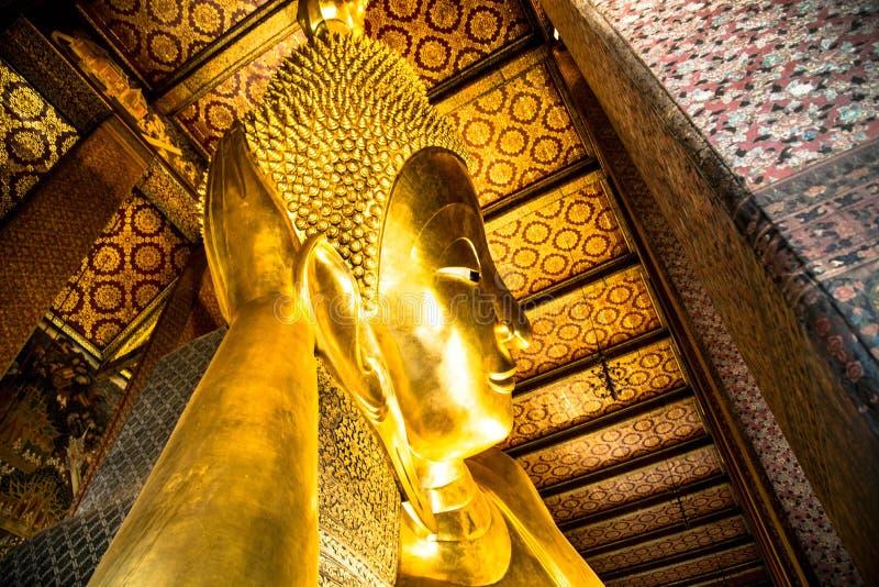 Lehnender Buddha-Statuen-Abschluss oben lizenzfreie stockbilder