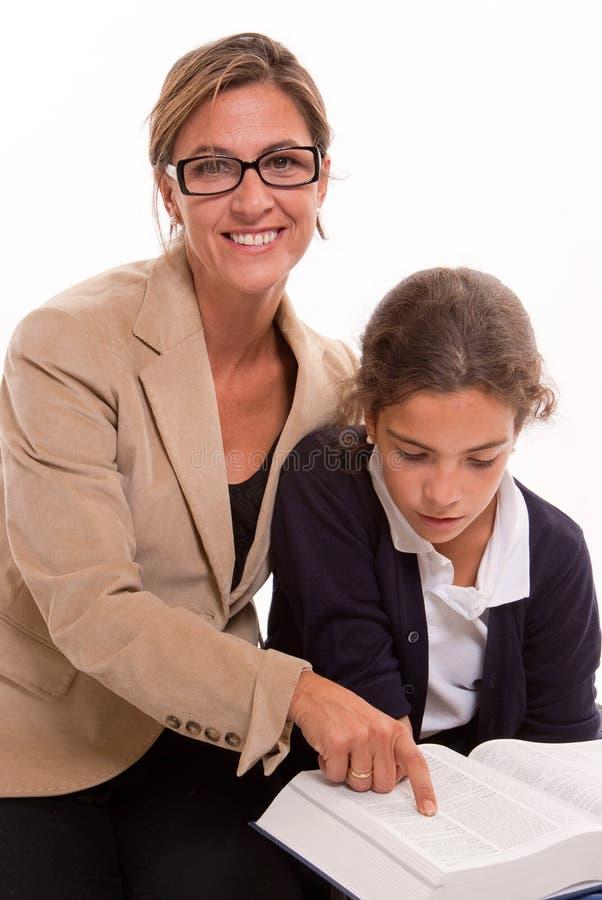 Lehrer und Schulmädchen stockfotos