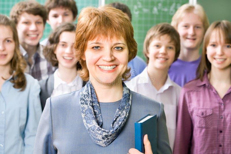 Lehrer und Studenten stockfotografie