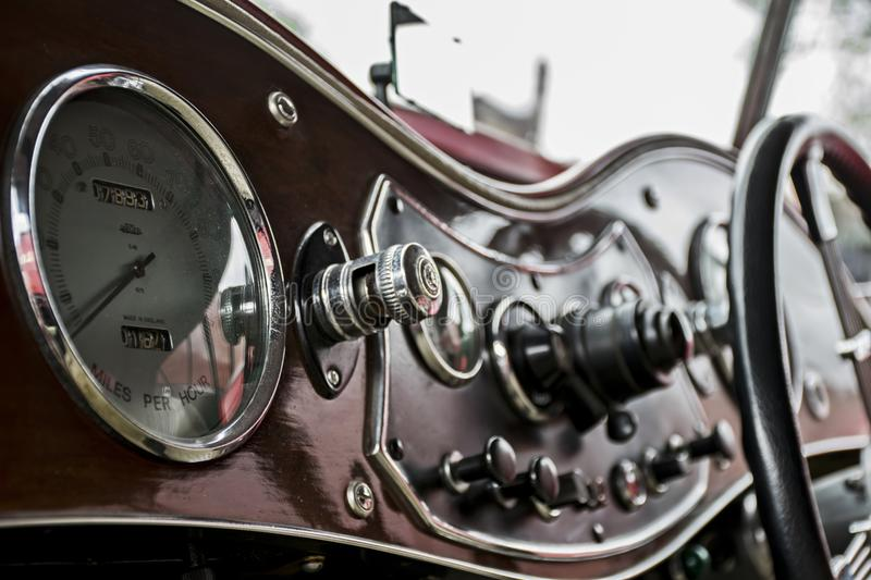 Polished wooden dash board on a vintage car at a classic car rally stock image