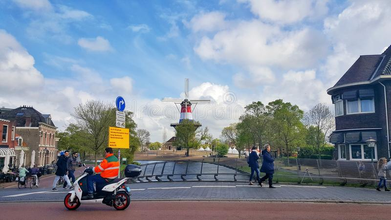 Windmill de Valk, Leiden. Leiden City in beautiful spring day, South Holland, The Netherlands. Windmill de valk in distance, painted in the color of red white royalty free stock image