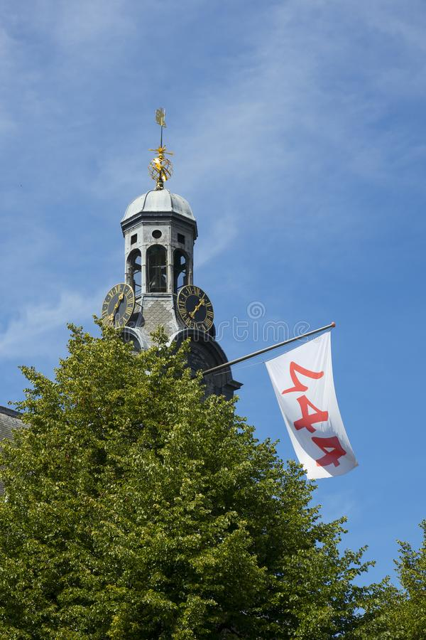 Tower of the university building at the Rapenburg with a flag for the celebration of 444 years royalty free stock images