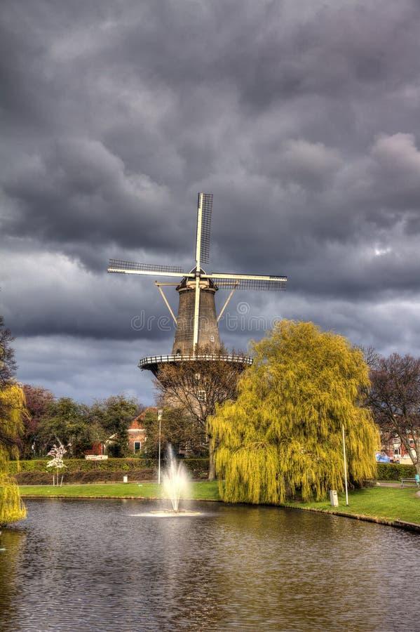 Leiden, mill 'de valk'. Dramatic sky over wind mill 'de valk' in Leiden, Netherlands. HDR royalty free stock photos