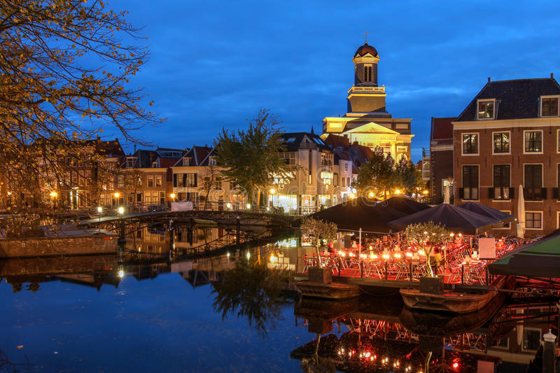 Leiden, The Netherlands. Night scene in Leiden, The Netherlands with Hartebrugkerk Church overlooking the Nieuwe Rijn Canal royalty free stock photography