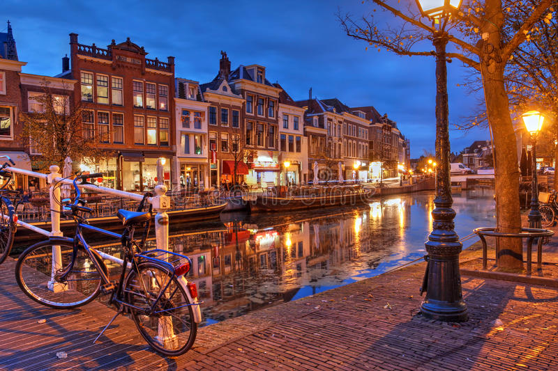 Leiden, Netherlands. Night scene in Leiden, The Netherlands with old houses along the Nieuwe Rijn Canal stock photos
