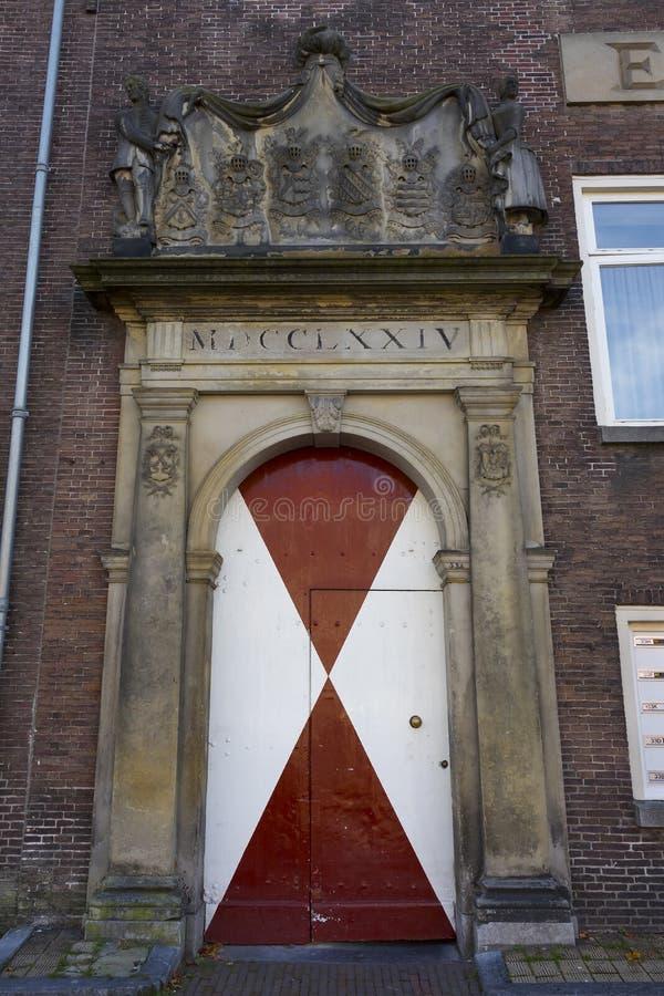 Door of the Meisjespoort, entrance to the Holy Ghost of Poor chidren Orphanage of 1774. Leiden, Netherlands - October 13, 2018; Leiden, Netherlands - October 13 stock image