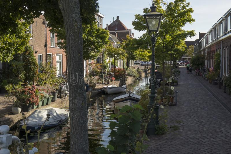 Leiden, Netherlands - September 17, 2018: Kijfgracht, houses along a small canal in the centre of the city in late afternoon stock image