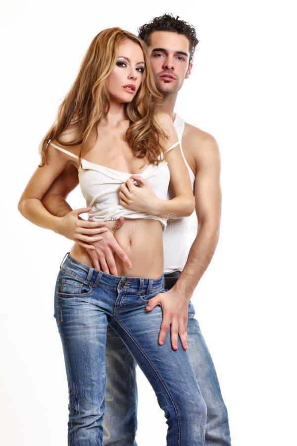 Leidenschaftliche Paare auf weißem Hintergrund lizenzfreies stockfoto