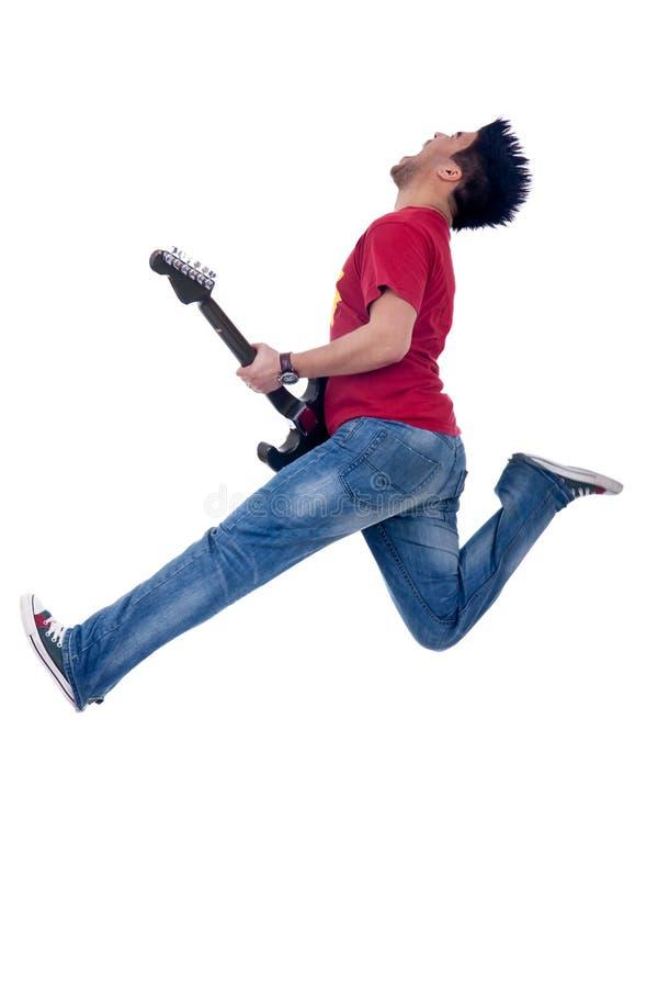 Leidenschaftliches Gitarristspringen stockfotos