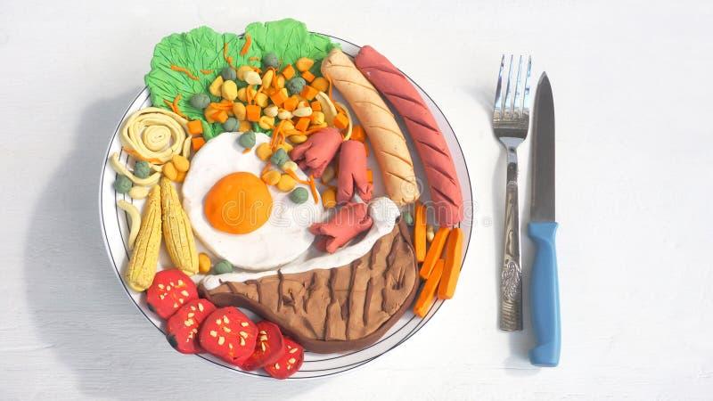 Leidt tot de combo vastgestelde vormende klei van het varkenskoteletlapje vlees van maaltijd royalty-vrije stock foto's