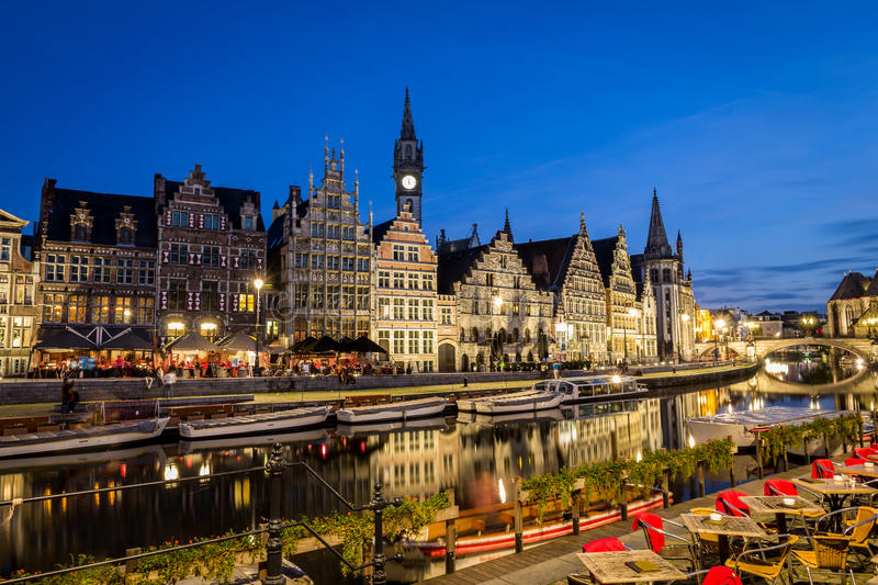 Leie river in Ghent, Belgium, Europe. Picturesque medieval buildings overlooking the Graslei harbor on Leie river in Ghent town, Belgium, Europe. Night-scene stock photo