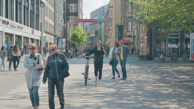 LEIPZIG, GERMANY - MAY 1, 2018. POV walk along the pedestrain street in city centre. LEIPZIG, GERMANY - MAY 1, 2018. POV walk along the pedestrain street stock photo
