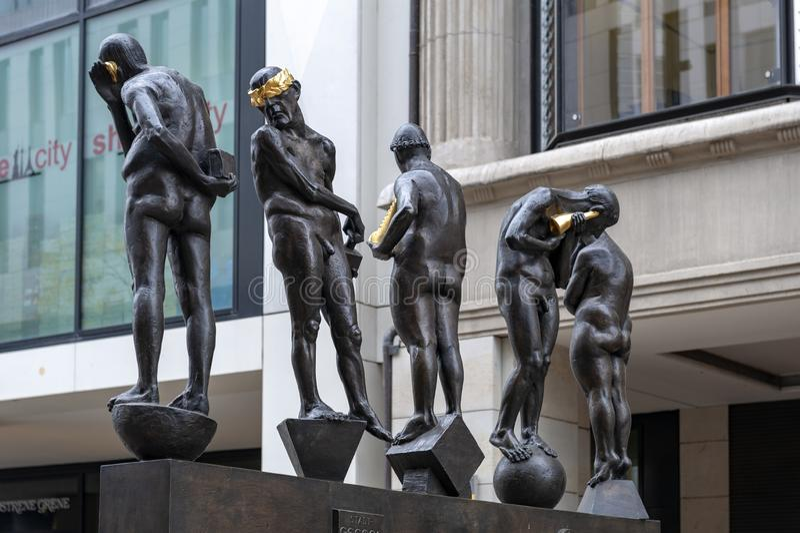 Bronze sculptures titled Untimely Contemporaries by Bernd Goebel installed on Grimmaische Street, Augustusplatz, Leipzig, Germany stock photos