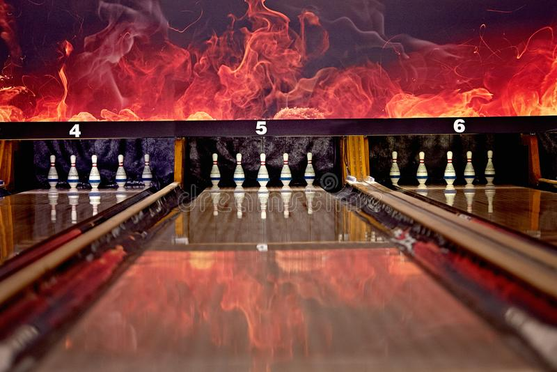 The leisure activity of bowling with lanes on fire! stock images