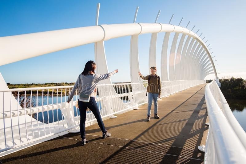 Leisure activity image of foreign tourists visiting Te Rewa Rewa bridge in New Plymouth, New Zealand stock images