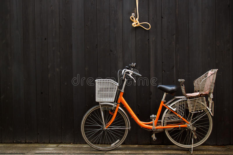 Download Leisure Bicycle In Front Of Black Wooden Fence Stock Photo - Image: 24442376