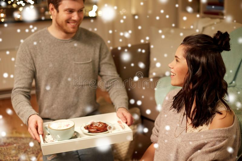 Happy couple with food on tray at home stock images
