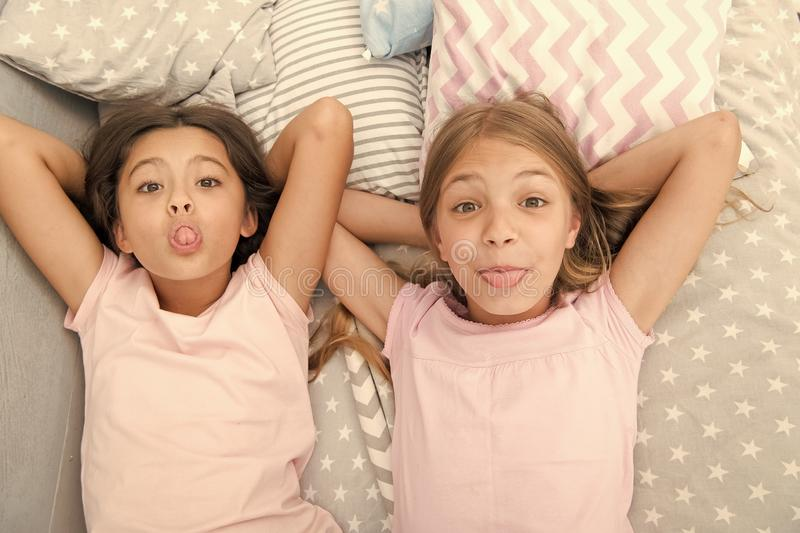 Leisure and fun. Having fun with best friend. Children playful cheerful mood having fun together. Pajama party and. Friendship. Sisters happy small kids stock photos