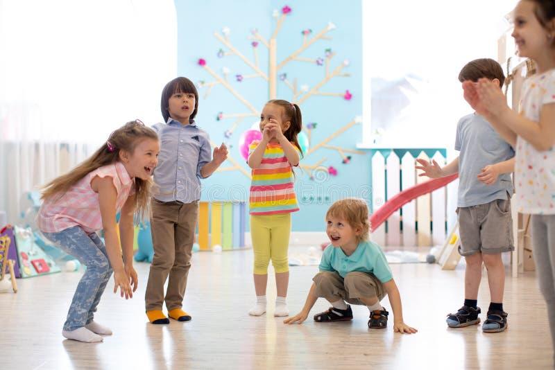 Leisure of preschool children. Acting and developing games for kids in kindergarten stock photo