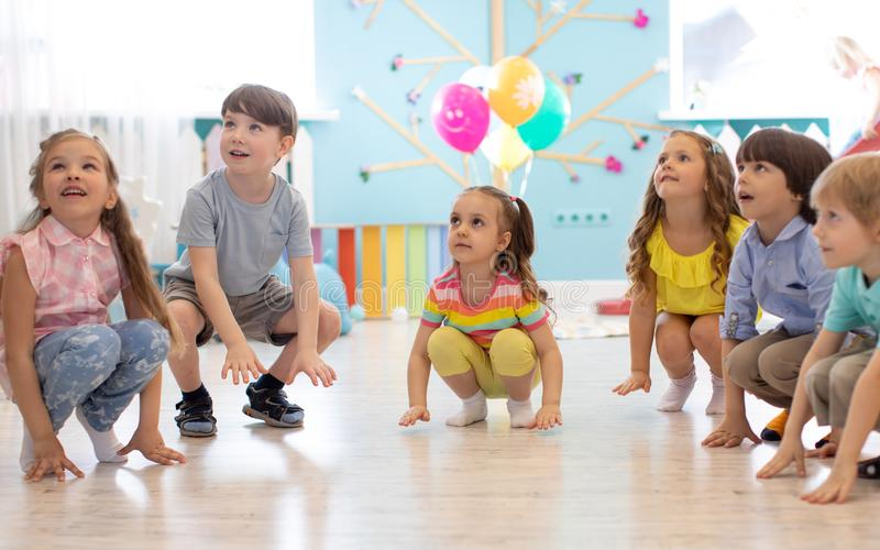 Leisure of preschool children. Entertainment at a children`s party. Acting and developing games for children stock photo