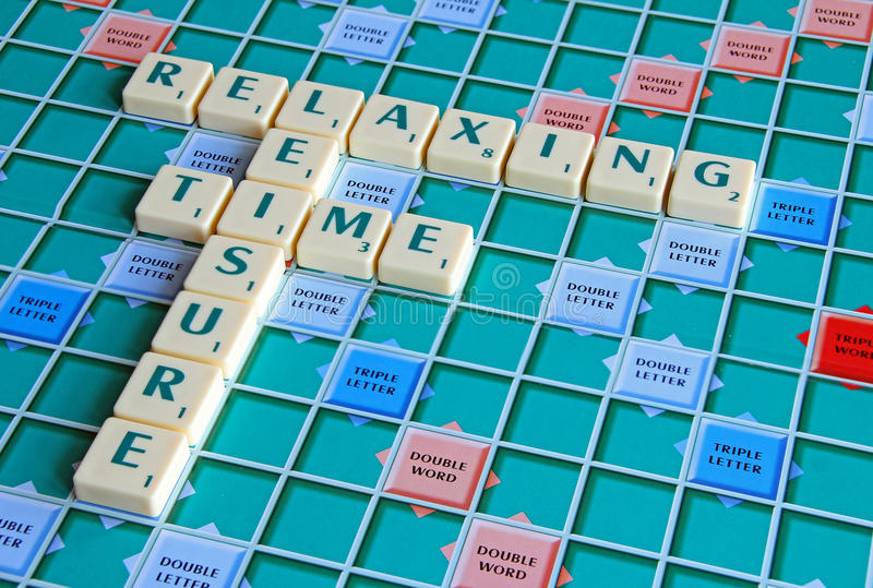 Leisure time gaming board. Photo of board game spelling out leisure time and gaming activities stock photography