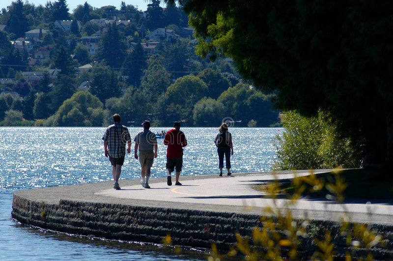 Leisure walk beside lake. A leisure walk beside Greenlake in Seattle Washington royalty free stock photos