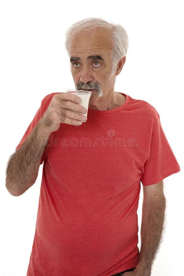 Leite bebendo do pensionista fotografia de stock royalty free