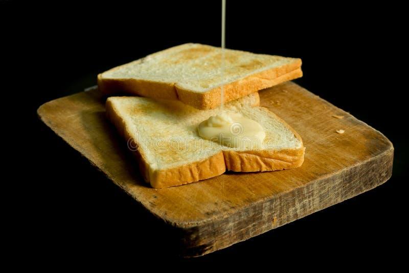 Leite condensado e pães Sweetened imagem de stock royalty free