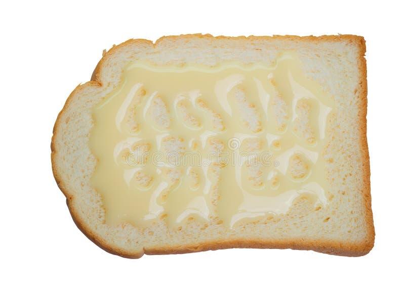 Leite condensado e pães Sweetened Trajeto de grampeamento fotos de stock