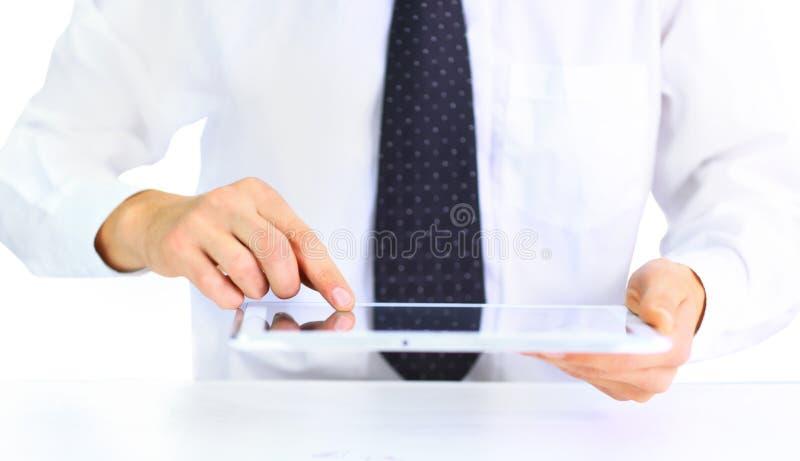 Leitura do homem de negócios no PC da tabuleta foto de stock royalty free