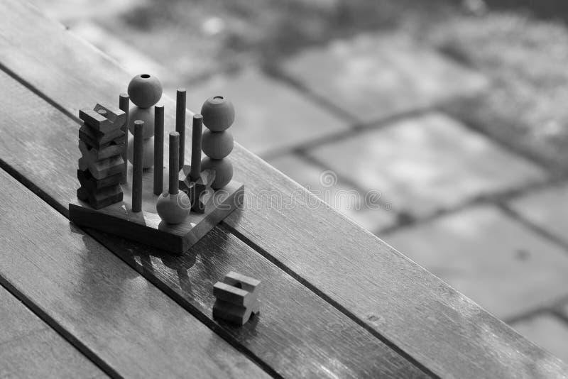 Lek för bräde för tå för OXEmuskelryckningtac wood genom att använda som bakgrundsaffärsriktningen som planerar begrepp arkivfoton