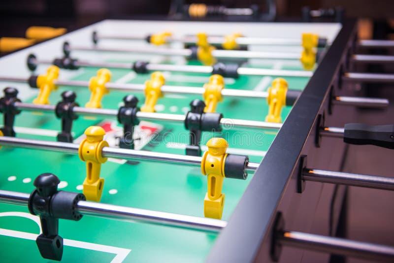 Lek för tabellfotboll- eller fotbollKicker arkivfoto