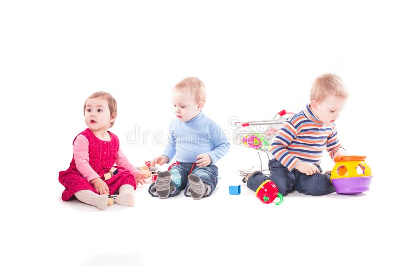 Lek för tre barn royaltyfria foton