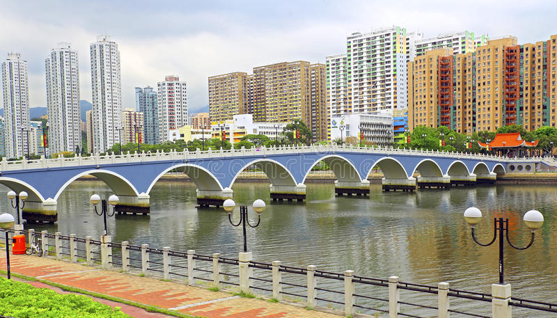 Lek yuen bridge of shatin, hong kong. Arc shaped lek yuen bridge over shing mun river and housing estates along shatin, hong kong royalty free stock photography