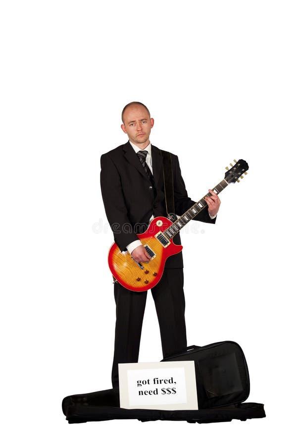 leka arbetslös för gitarrpengar arkivfoto