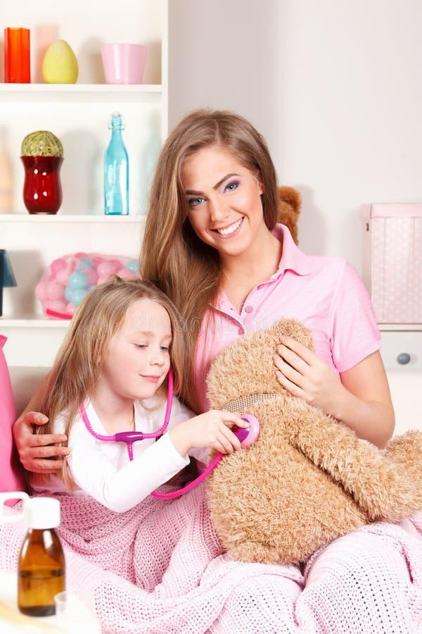 leka för barnmoder arkivbilder