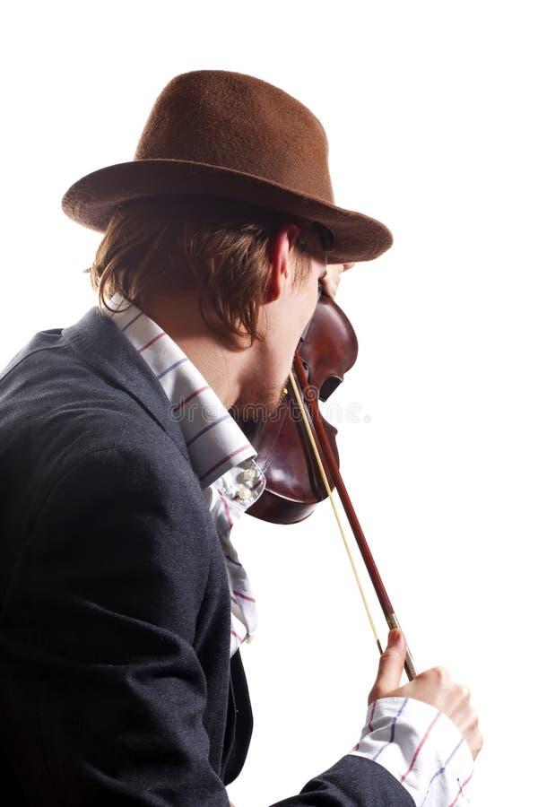 leka fiolviolinist för tillbaka hatt arkivfoton
