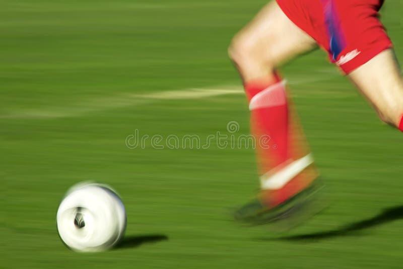 leka fotboll fotografering för bildbyråer
