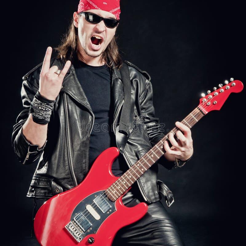leka rockstjärna för konsert arkivbild