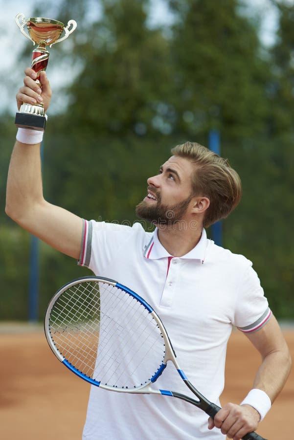 leka tennis för man royaltyfri bild