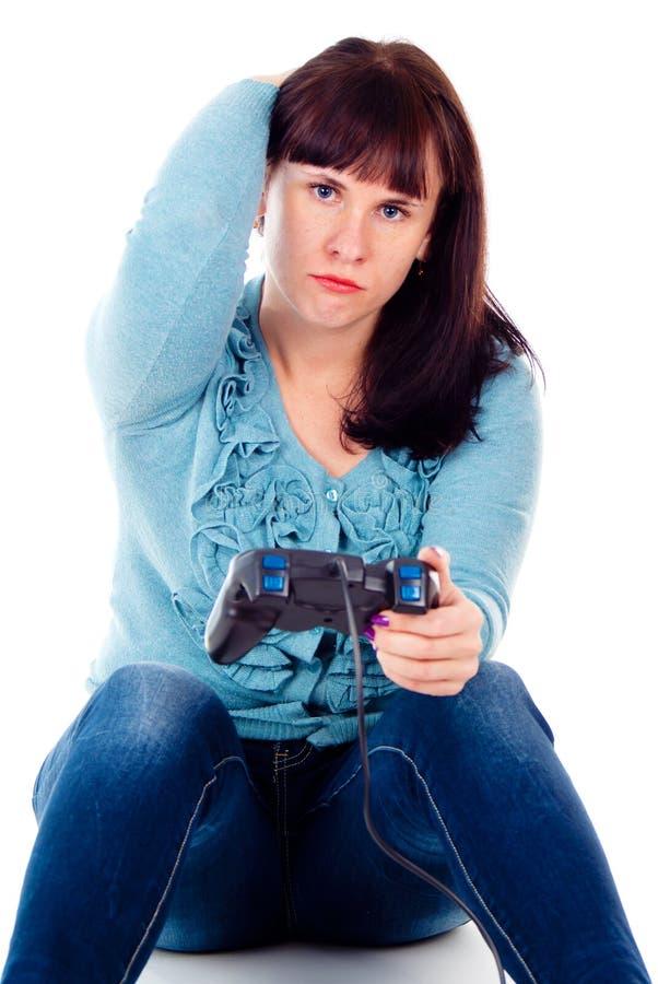 Leka videospel för en flicka, defeat royaltyfri fotografi
