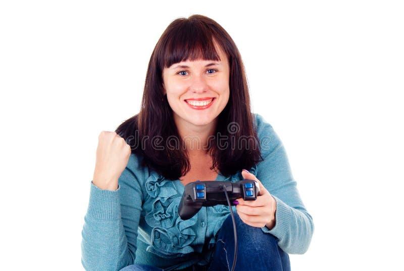 Leka videospel för en flicka som jublar segern royaltyfri bild