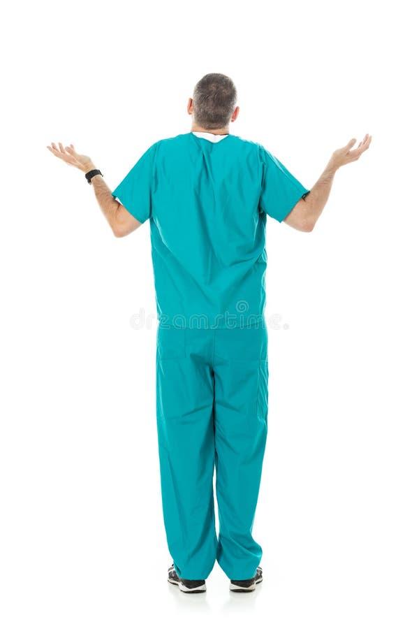 Lekarka: Tylni widok Niepewny Wzrusza ramionami mężczyzna fotografia royalty free