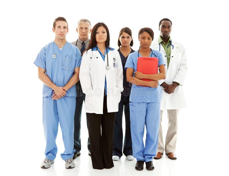 Lekarki: Linia Poważne lekarki i Poważny zdjęcie stock