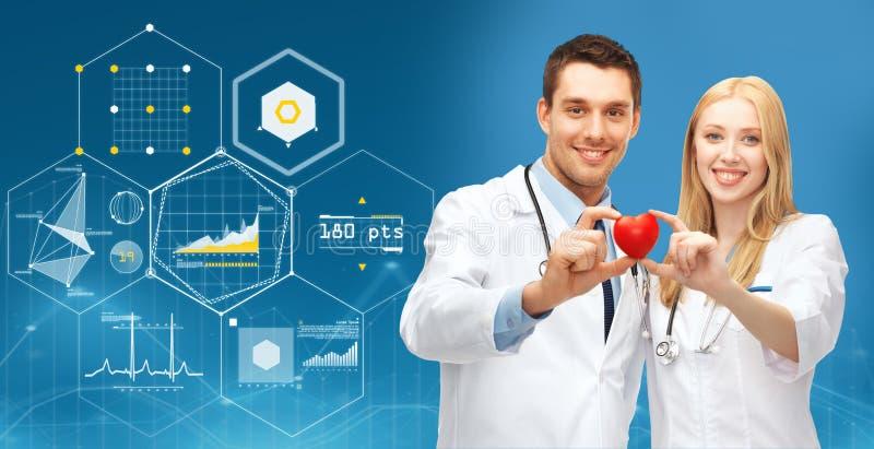 Lekarki z czerwonym sercem i mapy nad błękitem fotografia royalty free