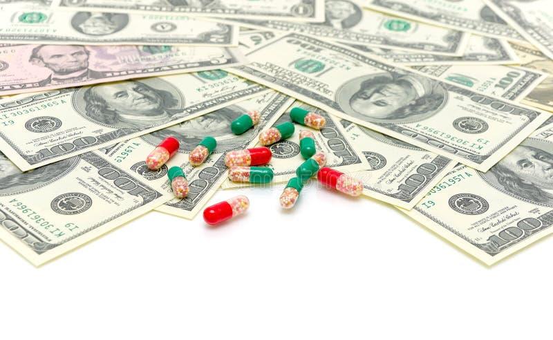 Leki i pieniądze na biały tle zdjęcia stock
