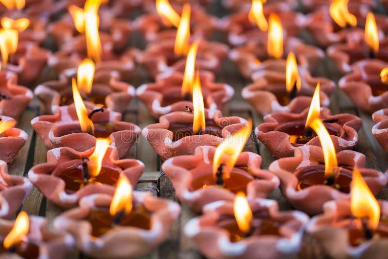 Lekka świeczka lampowy Buddha ono modli się zdjęcie stock