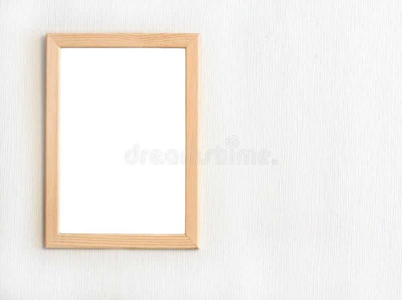 Lekka drewniana rama dla obrazka obwieszenia na biel ścianie obraz stock