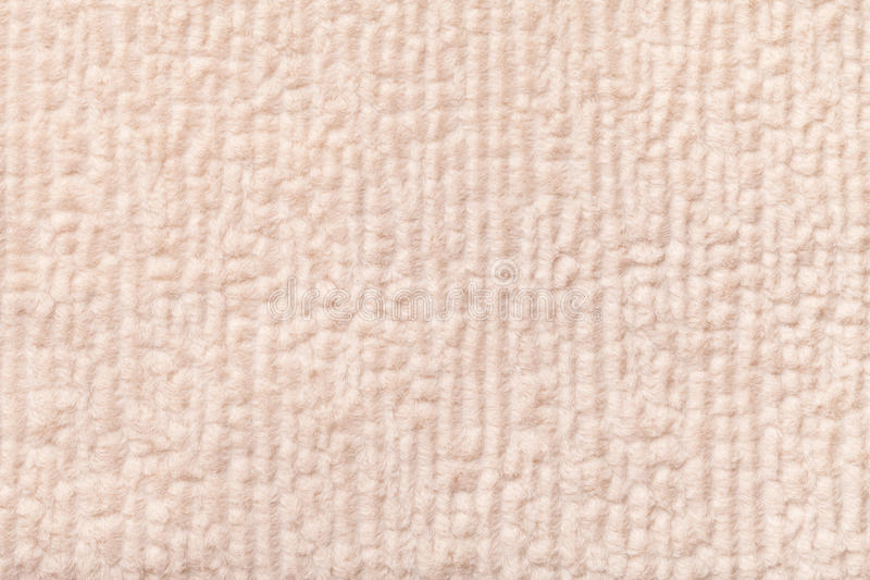 Lekki beżowy puszysty tło miękka część, wełnisty płótno Tekstura tekstylny zbliżenie obraz royalty free