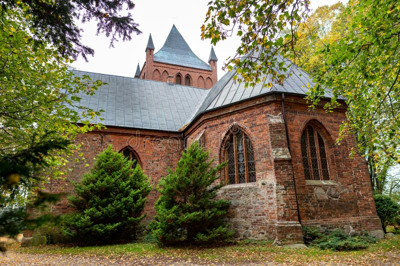 Lekno, zachodniopomorskie / Poland - October, 22, 2019: Christian church in Central Europe. Old brick temple building. Autumn season, ancient, architecture stock photography